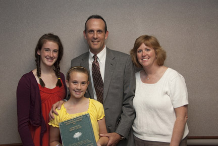 Kevin Cecco, a winner of the Griffith Award, with his wife, Stacey, and daughters, Madison and Delaney