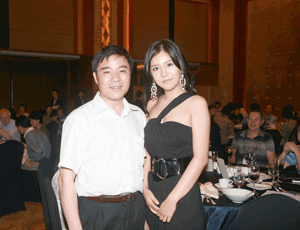 Jianqing Fan, past-president of the Institute of Mathematical Statistics, and Na Ri, 2008 Miss Korea and a junior majoring in statistics at Yonsei University, enjoy the conference dinner.