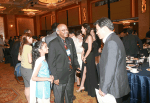 ASA President-elect Sastry Pantula, his daughter (to his left), and Byeong U. Park discuss statistics after the conference dinner.