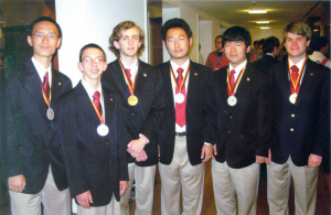 Proud of their accomplishment, the USA team shows off their medals. From left: Delong Meng, Evan O'Dorney, John Berman, Qinxuan Pan, Wenyu Cao, and Eric Larson
