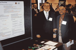 Peter Craigmile of The Ohio State University with Sastry Pantula, head of the Division of Mathematical Sciences at the National Science Foundation (NSF), during the Capitol Hill annual event highlighting research funded by the NSF