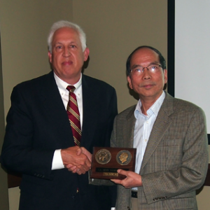C. F. Jeff Wu (right) of the Georgia Institute of Technology receives the 2012 Army Wilks Medal from 2010 recipient Arthur Fries of the Institute for Defense Analyses.