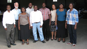 Two of the authors and a U.S. Census Bureau employee with their colleagues on the Zambian PES team
