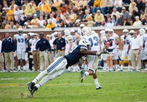 Ansah tackles Georgia Tech quarterback in 2012 game. [Photo Credit BYU Athletics]