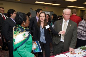 Genevera Allen discusses her poster with Rep. Jackson Lee (D-TX) and Rep. Jerry McNerney (D-CA).