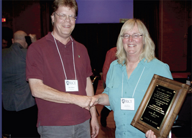 On March 22, San Antonio Chapter Vice President Peter Olofsson (left) presented the Don Owen Award to Leslie M. Moore for her outstanding contributions to research, statistical consultation, and service to the statistical community.