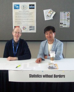 Statistics Without Borders (SWB) volunteers Ed Gracely (Drexel University) and Asaph Young Chun (U.S. Census Bureau) staff the SWB informational table at JSM 2012.