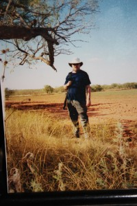 Clyde Martin stands in a field in what looks like Africa, but is really Lubbock, Texas.