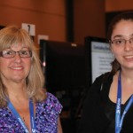 Lori Thombs and Cihan Caglayan take a break during the afternoon poster sessions.