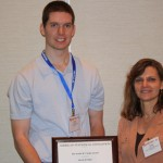 "David M. Kline, a graduate student in the PhD biostatistics program at The Ohio State University, accepts the first Lester ""Randy"" Curtin Award from Sally Curtin."
