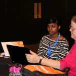 Rashida Washington (left) and Nola McDaniel share a laptop during a break between concurrent sessions.