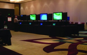 ASA Executive Director Ron Wasserstein helps set up a common area in which the CSP attendees and exhibitors will gather.