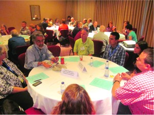 Chapter representatives take part in roundtable discussions during their JSM 2013 workshop.