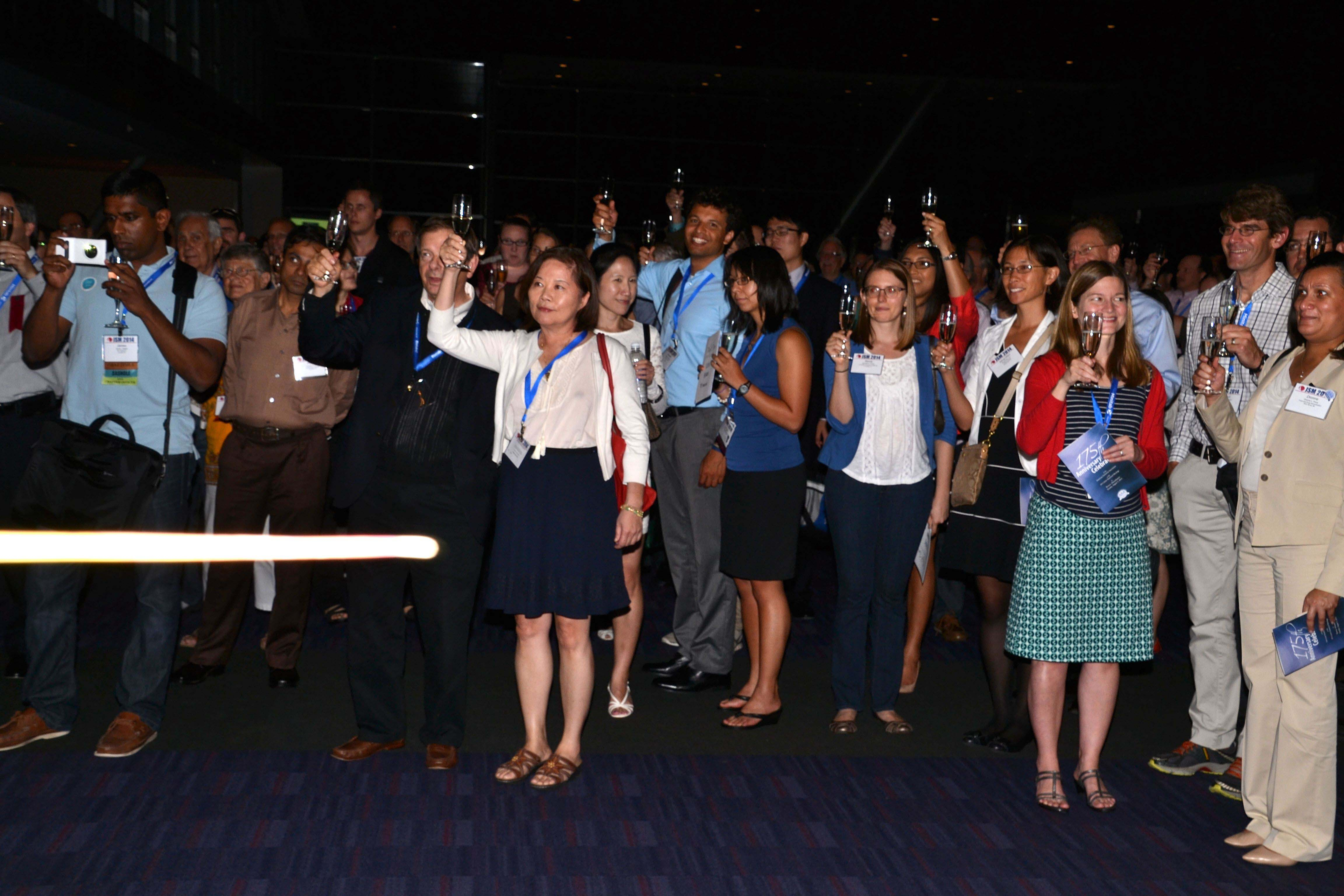 Attendees raise their glasses in a toast to the ASA's 175 years during the anniversary celebration