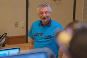 Dean of Emory College, Robin Forman, jumps into the DataFest spirit during judging.
