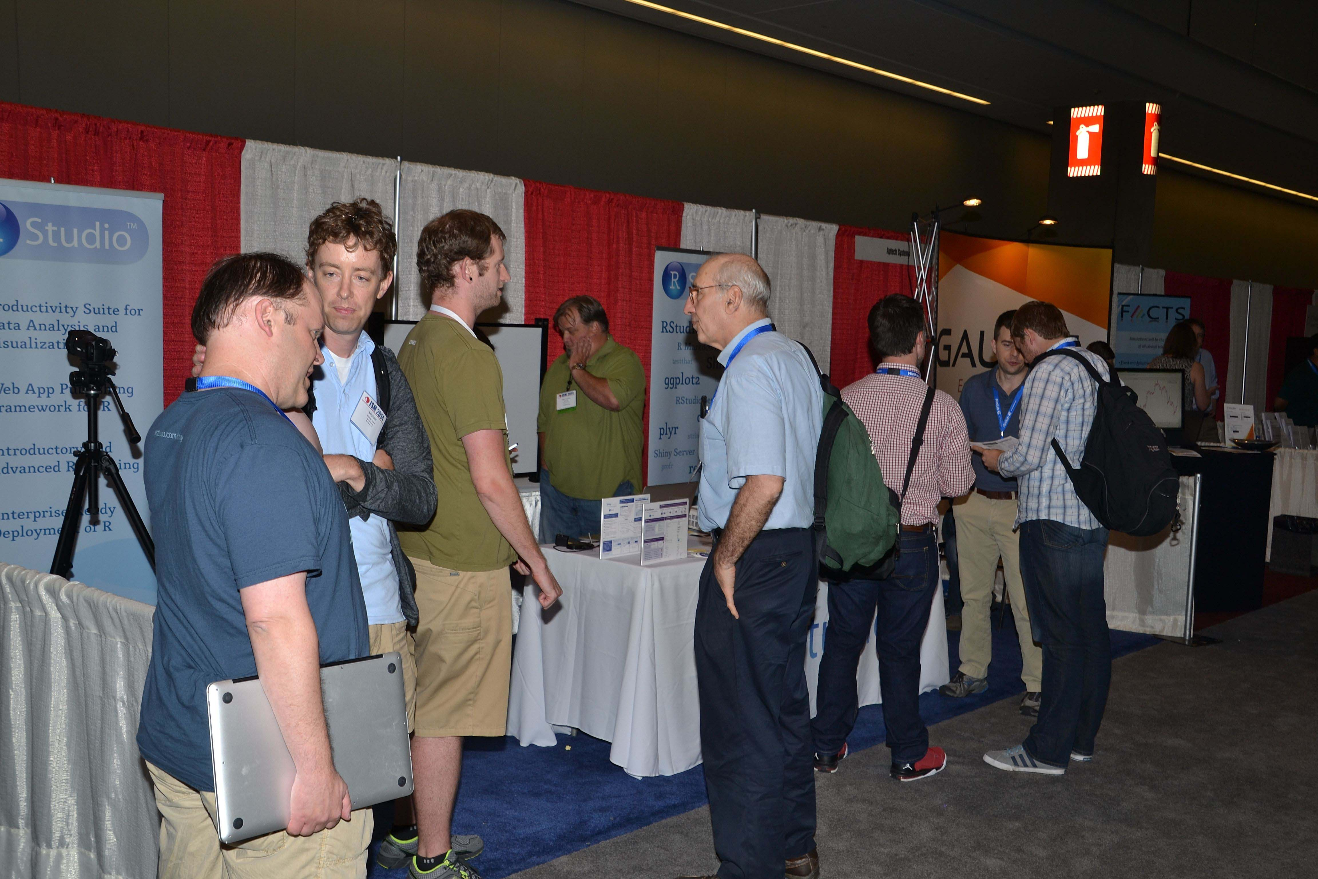 A group of attendees checks out the exhibit hall