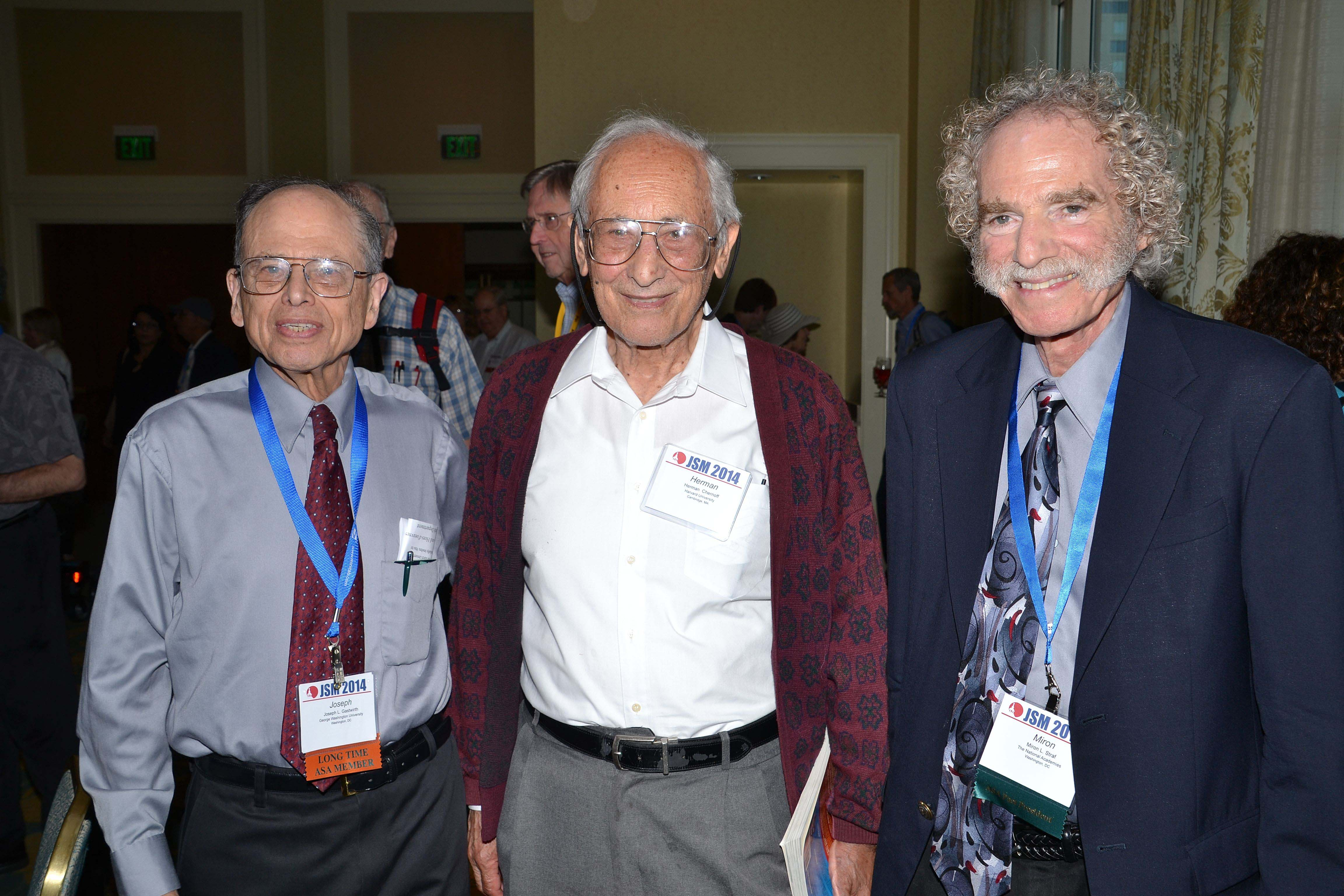 Joe Gastwirth, Herman Chernov, and Miron Straf catch up at the Longtime Member Reception