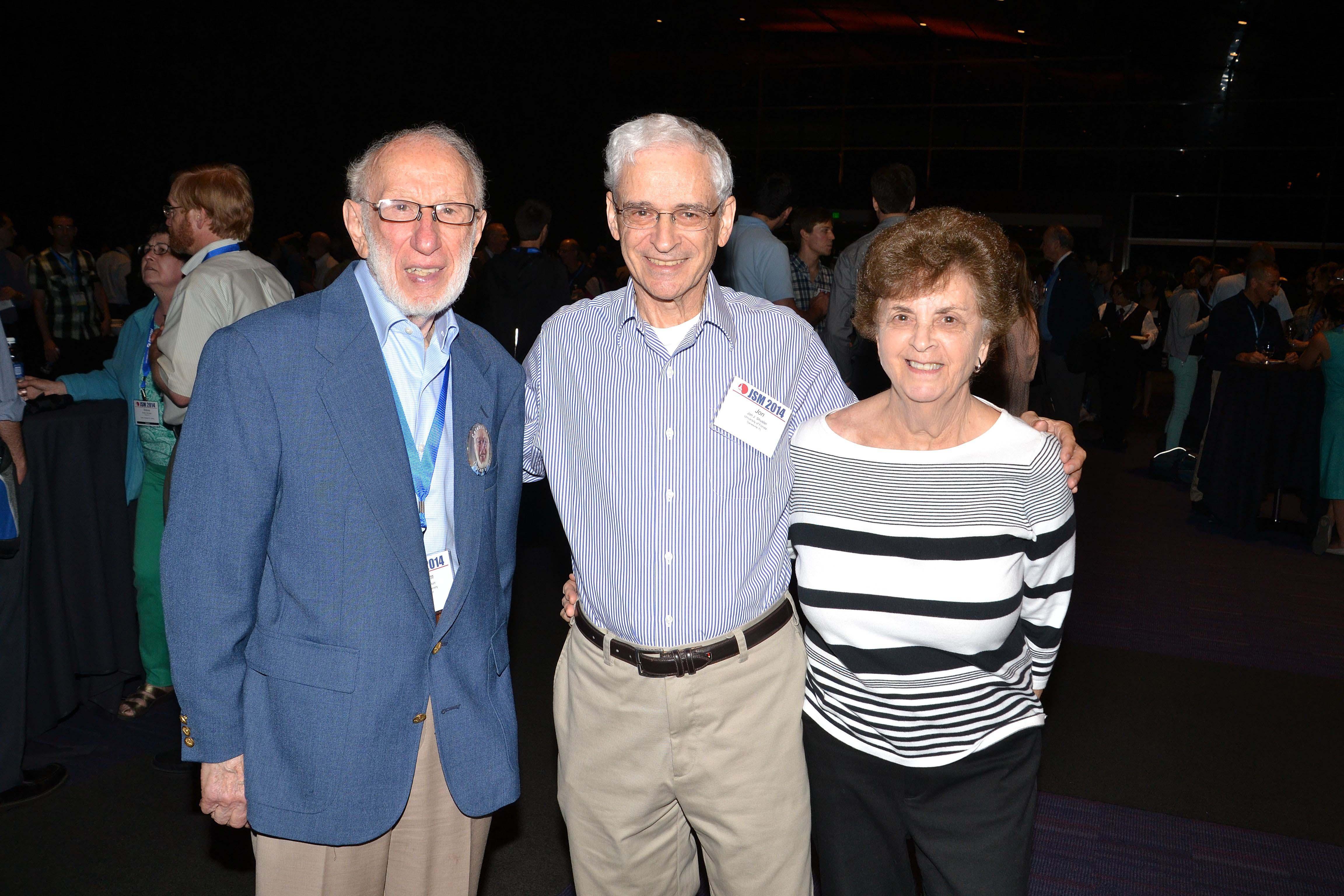 Ingram Olkin, John Shuster, and Sandy Shuster catch up during the Opening Mixer