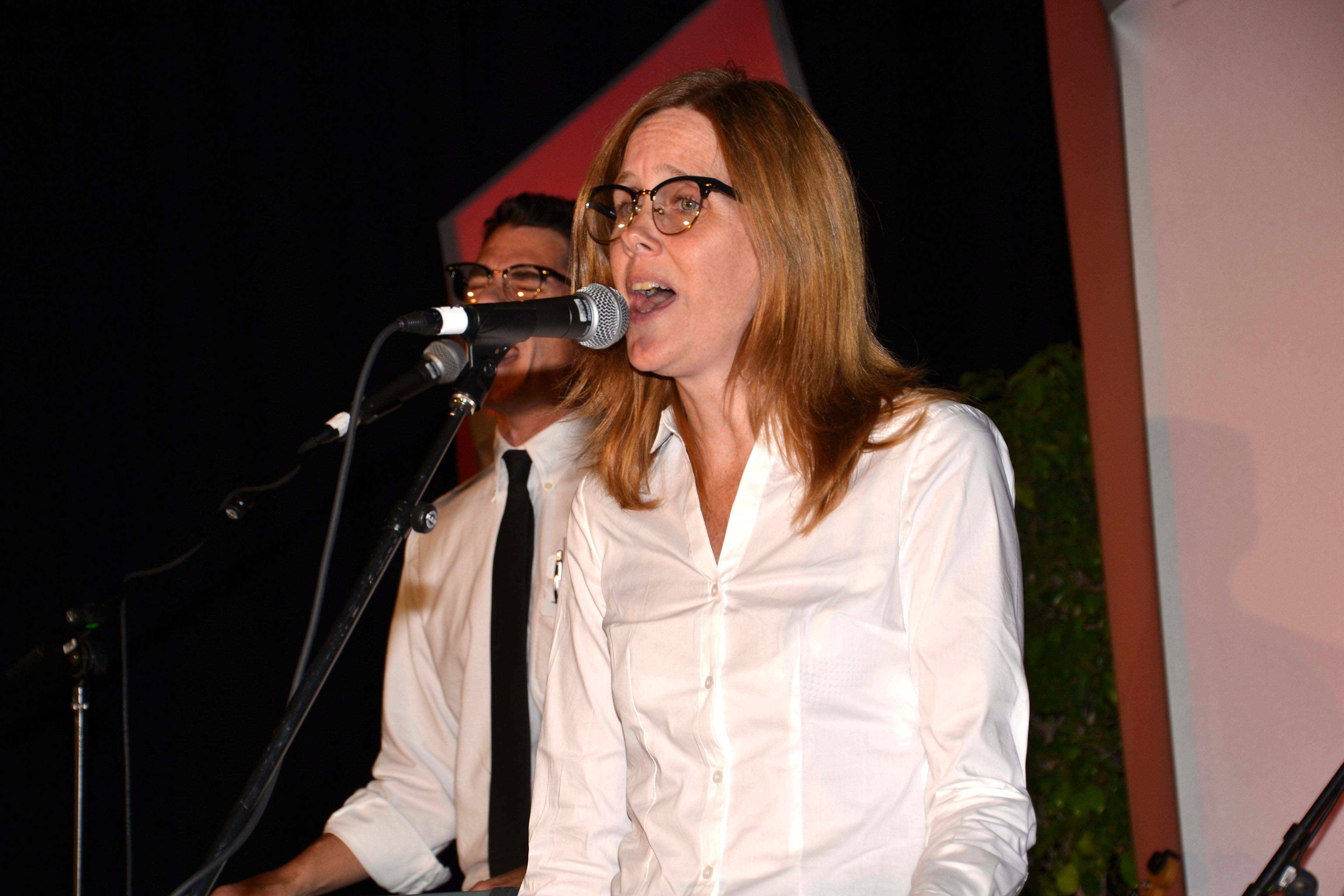 Brad Carlin and Jennifer Hill of The Imposteriors perform in the ASA's Got Talent competition