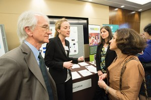 SAMSI Director Richard Smith talks with NSF Director France Cordova while Jessi Cisewski of Carnegie Mellon University and SAMSI postdoc Kimberly Kaufeld discuss their poster with attendees.(Photo provided by Scavone Photography)