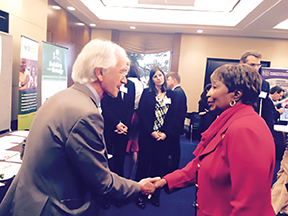 SAMSI Director Richard Smith shakes hands with Rep. Eddie Bernice Johnson. (Photo provided by Kasey White of the Geological Society of America.)
