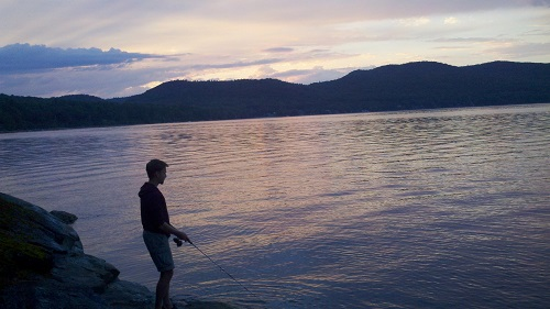 James Earle fishes on the rocky shore of Lake Champlain in upstate New York, his preferred refuge from civilization.