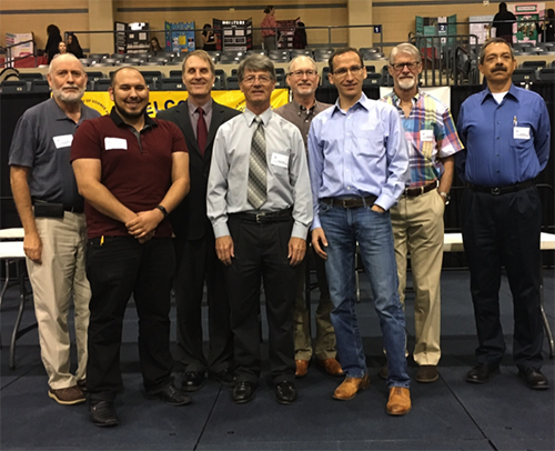 Judges, from left: (front row) Vincent Spadafore, Howard Monroe, and Jared Schettler (back row): John Schoolfield, Michael Mader, Danny Sharon, Steve Zinkgraf, and Jesus Cuellar-Fuentes