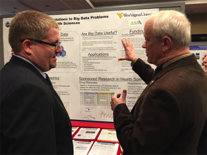 Mark Culp discusses his research with Rep. Jerry McNerney (D-CA), a PhD mathematician.